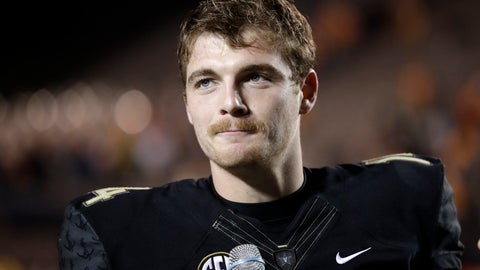 """<p>               FILE - In this Nov. 24, 2018, file photo, Vanderbilt quarterback Kyle Shurmur is interviewed after Vanderbilt beat Tennessee in an NCAA college football game, in Nashville, Tenn. There's one quarterback at the NFL scouting combine that New York Giants coach Pat Shurmur has absolutely fallen in love with. It's Kyle Shurmur, his 22-year-old son who threw 50 touchdowns over the last two seasons as Vanderbilt's starter. """"Well, I'm extremely proud of him,"""" the Giants coach said. (AP Photo/Mark Humphrey, File)             </p>"""