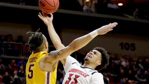 <p>               Louisville's Jordan Nwora (33) goes to the basket against Minnesota's Amir Coffey (5) during the first half of a first round men's college basketball game in the NCAA Tournament, in Des Moines, Iowa, Thursday, March 21, 2019. (AP Photo/Nati Harnik)             </p>
