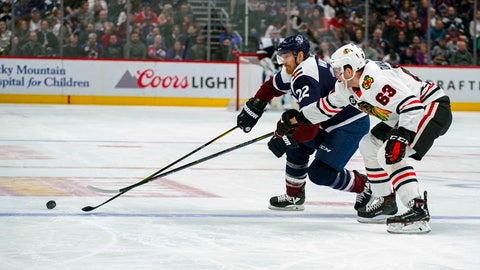 <p>               Colorado Avalanche center Colin Wilson (22) and Chicago Blackhawks defenseman Carl Dahlstrom (63) chase the puck during the second period of an NHL hockey game, Saturday, March 23, 2019 in Denver. (AP Photo/Jack Dempsey)             </p>