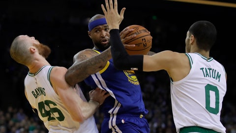 <p>               Golden State Warriors' DeMarcus Cousins, center, fouls Boston Celtics' Aron Baynes, left, as he looks to pass the ball away from Jayson Tatum (0) during the first half of an NBA basketball game Tuesday, March 5, 2019, in Oakland, Calif. (AP Photo/Ben Margot)             </p>