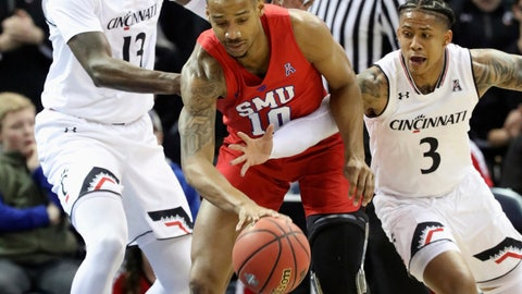 <p>               SMU guard William Douglas fights to keep control of the ball from Cincinnati's Rashawn Fredericks and Tre Scott during the first half of an NCAA college basketball game at the American Athletic Conference men's tournament Friday, March 15, 2019, in Memphis, Tenn. (AP Photo/Troy Glasgow)             </p>