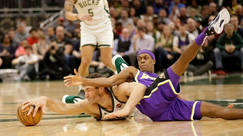 <p>               Milwaukee Bucks' Brook Lopez, left, and Los Angeles Lakers' Rajon Rondo reach for a loose ball during the second half of an NBA basketball game Tuesday, March 19, 2019, in Milwaukee. (AP Photo/Jeffrey Phelps)             </p>