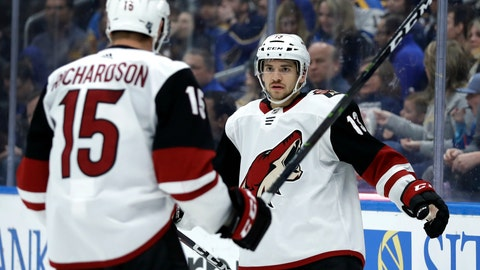 <p>               Arizona Coyotes' Vinnie Hinostroza, right, is congratulated by Brad Richardson after scoring during the third period of an NHL hockey game against the St. Louis Blues, Tuesday, March 12, 2019, in St. Louis. The Coyotes won 3-1. (AP Photo/Jeff Roberson)             </p>