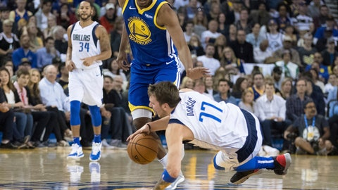 <p>               Dallas Mavericks forward Luka Doncic (77) collides with Golden State Warriors center Kevon Looney in the first half of an NBA basketball game Saturday, March 23, 2019, in Oakland, Calif. (AP Photo/John Hefti)             </p>