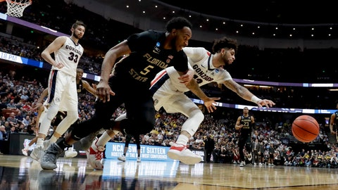 <p>               Gonzaga guard Josh Perkins, right, and Florida State guard PJ Savoy chase a loose ball during the second half an NCAA men's college basketball tournament West Region semifinal Thursday, March 28, 2019, in Anaheim, Calif. (AP Photo/Marcio Jose Sanchez)             </p>