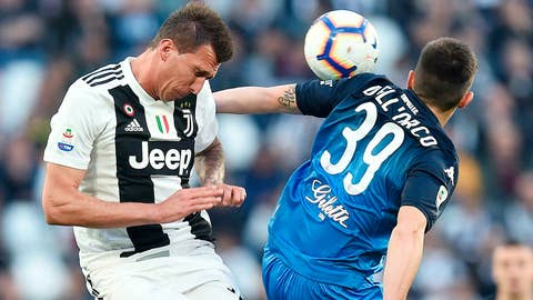<p>               Juventus' Mario Mandzukic, left, and Empoli's Cristian Dell'Orco vie for the ball during the Serie A soccer match between Juventus and Empoli at the Turin Allianz Stadium, Italy, Saturday, March 30, 2019. (Alessandro Di Marco/ANSA via AP)             </p>