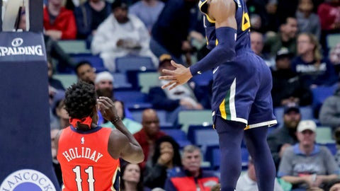 <p>               Utah Jazz guard Donovan Mitchell (45) finishes a steal with a dunk on New Orleans Pelicans guard Jrue Holiday (11) in the first half of an NBA basketball game in New Orleans, Wednesday, March 6, 2019. (AP Photo/Scott Threlkeld)             </p>