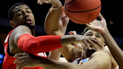 <p>               Ohio State's Keyshawn Woods, left, and Iowa State's Nick Weiler-Babb battle for a rebound during the first half of a first round men's college basketball game in the NCAA Tournament Friday, March 22, 2019, in Tulsa, Okla. (AP Photo/Charlie Riedel)             </p>