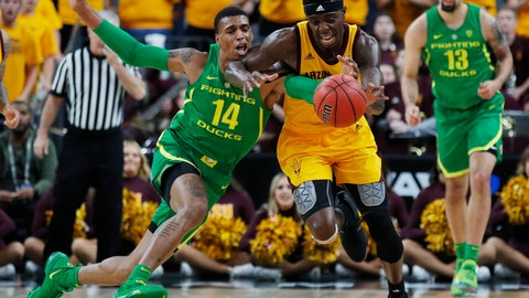 <p>               Oregon's Kenny Wooten (14) tries to steal the ball from Arizona State's Zylan Cheatham during the first half of an NCAA college basketball game in the semifinals of the Pac-12 men's tournament Friday, March 15, 2019, in Las Vegas. (AP Photo/John Locher)             </p>