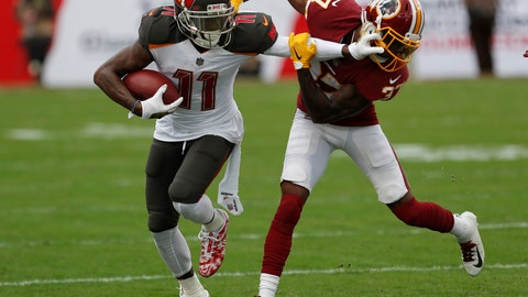<p>               FILE - In this Sunday, Nov. 11, 2018 file photo, Tampa Bay Buccaneers wide receiver DeSean Jackson (11) stiff arms Washington Redskins cornerback Greg Stroman (37) during the second half of an NFL football game in Tampa, Fla. Two people familiar with the deal tell The Associated Press the Philadelphia Eagles have agreed to acquire wide receiver DeSean Jackson from Tampa Bay along with a 2020 seventh-round draft pick for a sixth-round pick this year. The deal is contingent upon Jackson agreeing to a new contract, according to one of the sources who spoke on condition of anonymity late Monday, March 11, 2019 because terms haven't been finalized. (AP Photo/Mark LoMoglio, File)             </p>
