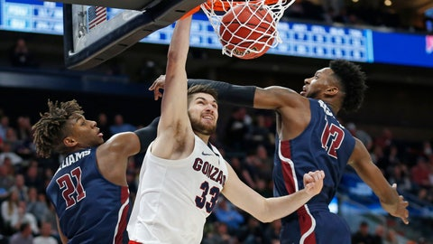 <p>               Gonzaga forward Killian Tillie (33) dunks between Fairleigh Dickinson's Elyjah Williams (21) and Kaleb Bishop (12) during the second half of a first-round game in the NCAA men's college basketball tournament Thursday, March 21, 2019, in Salt Lake City. (AP Photo/Rick Bowmer)             </p>