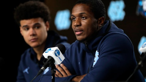 <p>               North Carolina's Kenny Williams, right, answers a question as teammate Cameron Johnson listens during a news conference at the NCAA men's college basketball tournament Thursday, March 28, 2019, in Kansas City, Mo. North Carolina plays Auburn in a Midwest Regional semifinal on Friday. (AP Photo/Orlin Wagner)             </p>