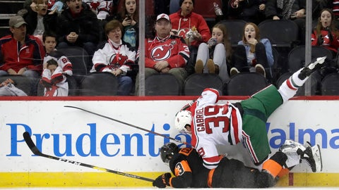 <p>               New Jersey Devils right wing Kurtis Gabriel (39) falls onto Philadelphia Flyers defenseman Radko Gudas (3), of the Czech Republic, after a collision along the boards during the third period of an NHL hockey game, Friday, March 1, 2019, in Newark, N.J. The Flyers won 6-3. (AP Photo/Julio Cortez)             </p>