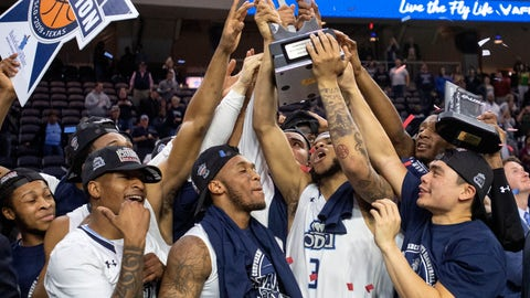 <p>               Old Dominion players hoist the trophy after defeating Western Kentucky 62-56 in an NCAA college basketball game for the Conference USA men's tournament championship Saturday, March 16, 2019, in Frisco, Texas. (AP Photo/Jeffrey McWhorter)             </p>