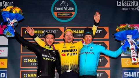 <p>               Slovenia's Primoz Roglic, winner of the 54th Tirreno Adriatico cycling race, center, celebrates on the podium with second-placed Britain's Adam Yates, left, and third-placed Denmark's Jakob Fuglsang,  in San Benedetto del Tronto, central Italy, Tuesday, March 19, 2019. (Dario Belinghieri/ANSA via AP)             </p>