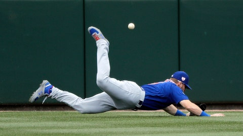 <p>               Chicago Cubs center fielder Ian Happ tumbles to the turf after diving for, and missing, a fly ball that fell in for a two-run double by Oakland Athletics' Khris Davis in the third inning of a spring training baseball game, Wednesday, March 13, 2019, in Mesa, Ariz. (AP Photo/Elaine Thompson)             </p>