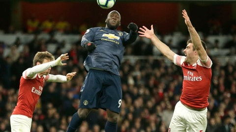 <p>               Arsenal's Nacho Monreal, left, Arsenal's Sokratis Papastathopoulos, right, and Manchester United's Romelu Lukaku challenge for the ball during the English Premier League soccer match between Arsenal and Manchester United at the Emirates Stadium in London, Sunday, March 10, 2019. (AP Photo/Tim Ireland)             </p>