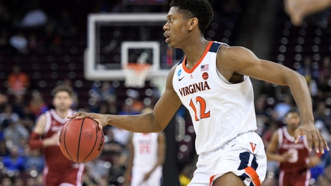 <p>               Virginia guard De'Andre Hunter looks to make a play against Oklahoma during the second half of a second-round game in the NCAA men's college basketball tournament Sunday, March 24, 2019, in Columbia, S.C. Virginia defeated Oklahoma 63-51. (AP Photo/Sean Rayford)             </p>