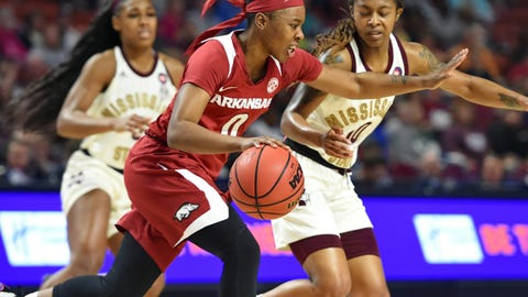 <p>               Arkansas's A'Tyanna Gaulden, center, drives while defended by Mississippi Sate's Jazzmun Holmes, right, and Anriel Howard during the first half of an NCAA college basketball championship game in the Southeastern Conference women's tournament, Sunday, March 10, 2019, in Greenville, S.C. (AP Photo/Richard Shiro)             </p>