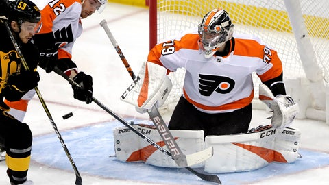 <p>               Pittsburgh Penguins' Teddy Blueger (53) can't get his stick on a rebound in front of Philadelphia Flyers goaltender Carter Hart (79) with Michael Raffl (12) defending during the first period of an NHL hockey game in Pittsburgh, Sunday, March 17, 2019. (AP Photo/Gene J. Puskar)             </p>