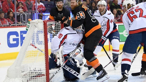 <p>               Philadelphia Flyers right wing Jakub Voracek (93), of the Czech Republic, collides with Washington Capitals goaltender Braden Holtby (70) during the second period of an NHL hockey game, Sunday, March 24, 2019, in Washington. Capitals left wing Carl Hagelin (62) and defenseman Brooks Orpik (44) look on. (AP Photo/Nick Wass)             </p>