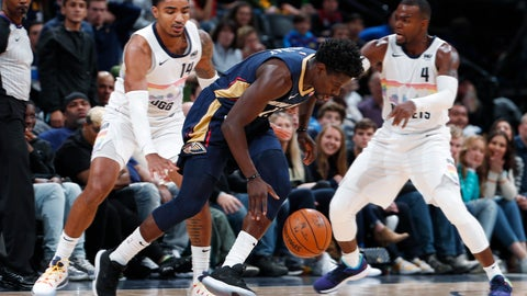 <p>               New Orleans Pelicans guard Jrue Holiday, center, drives past Denver Nuggets guard Gary Harris, left, and forward Paul Millsap on the way to scoring a basket during the second half of an NBA basketball game Saturday, March 2, 2019, in Denver. The Pelicans won 120-112. (AP Photo/David Zalubowski)             </p>
