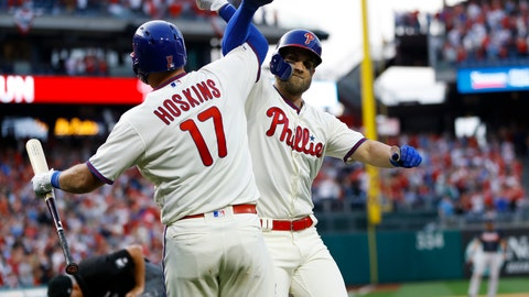 <p>               Philadelphia Phillies' Bryce Harper, right, and Rhys Hoskins celebrate after Harper's home run during the seventh inning of a baseball game against the Atlanta Braves, Saturday, March 30, 2019, in Philadelphia. (AP Photo/Matt Slocum)             </p>