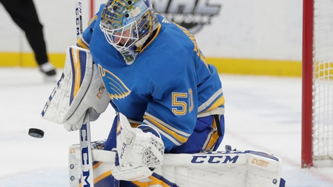 <p>               St. Louis Blues goaltender Jordan Binnington (50) makes a stick-save in the first period of an NHL hockey game against the Tampa Bay Lightning, Saturday, March 23, 2019, in St. Louis. (AP Photo/Tom Gannam)             </p>