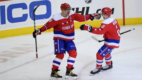 <p>               Washington Capitals left wing Alex Ovechkin (8), of Russia, celebrates his goal with defenseman Matt Niskanen (2) during the third period of an NHL hockey game against the Carolina Hurricanes, Tuesday, March 26, 2019, in Washington. The Capitals won 4-1. (AP Photo/Nick Wass)             </p>