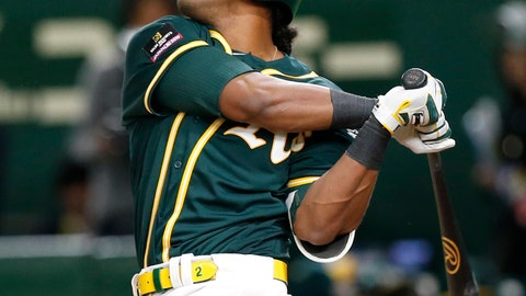 <p>               Oakland Athletics designated hitter Khris Davis hits a grand slam off Nippon Ham Fighters pitcher Naoya Ishikawa in the ninth inning of their preseason exhibition baseball game at Tokyo Dome in Tokyo Monday, March 18, 2019. The Athletics ended a 6-6 draw. (AP Photo/Toru Takahashi)             </p>