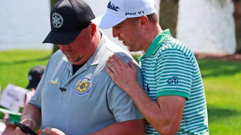 <p>               Justin Thomas, right, looks at the phone of Florida Fish and Wildlife Conservation Commission officer John Booth on the third hole during the second round of the Honda Classic golf tournament, Friday, March 1, 2019, in Palm Beach Gardens, Fla. (AP Photo/Wilfredo Lee)             </p>