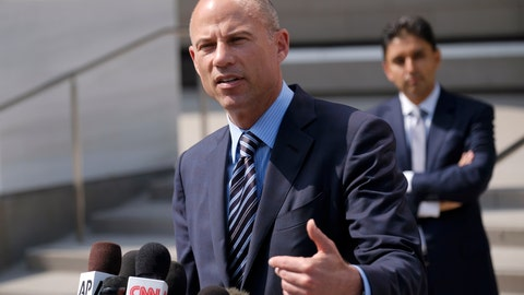 <p>               FILE - In this July 27, 2018 file photo, attorney Michael Avenatti replies to questions by reporters during a news conference in front of the U.S. Federal Courthouse in Los Angeles. U.S. prosecutors announced Monday, March 25, 2019, they have charged Avenatti with extortion and bank and wire fraud. A spokesman for the U.S. attorney in Los Angeles said Avenatti was arrested Monday in New York. (AP Photo/Richard Vogel, File)             </p>
