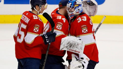 <p>               Florida Panthers center Henrik Borgstrom (95) and goaltender James Reimer (34) congratulate goaltender Sam Montembeault (33) after they defeated the Minnesota Wild during an NHL hockey game, Friday, March 8, 2019, in Sunrise, Fla. (AP Photo/Wilfredo Lee)             </p>