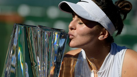 <p>               Bianca Andreescu, of Canada, kisses her trophy after defeating Angelique Kerber, of Germany, in the women's final at the BNP Paribas Open tennis tournament Sunday, March 17, 2019, in Indian Wells, Calif. Andreescu won 6-4, 3-6, 6-4. (AP Photo/Mark J. Terrill)             </p>