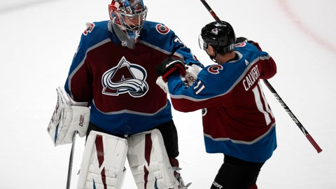 <p>               Colorado Avalanche goaltender Philipp Grubauer, left, is congratulated by left wing Matt Calvert after stopping a shot by Arizona Coyotes center Vinnie Hinostroza during the shootout in an NHL hockey game Friday, March 29, 2019, in Denver. The Avalanche won 3-2. (AP Photo/David Zalubowski)             </p>