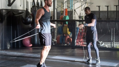 """<p>               In this undated image provided courtesy of Centr, actor Chris Hemsworth, left, and Michael Olajide Jr. workout. When Hemsworth sought """"experts"""" to contribute to a fitness and health app called Centr, one place he turned was to the boxing ring. He found Olajide Jr., a former middleweight contender who literally lost an eye to his sport. (Courtesy of Centr via AP)             </p>"""