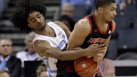 <p>               North Carolina's Coby White, left, reaches across to strip the ball from Louisville's Christen Cunningham, right, during the first half of an NCAA college basketball game in the Atlantic Coast Conference tournament in Charlotte, N.C., Thursday, March 14, 2019. (AP Photo/Chuck Burton)             </p>