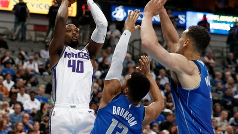<p>               Sacramento Kings forward Harrison Barnes (40) goes up for a shot as Dallas Mavericks' Jalen Brunson (13) and Dwight Powell, right, defend in the first half of an NBA basketball game in Dallas, Tuesday, March 26, 2019. (AP Photo/Tony Gutierrez)             </p>