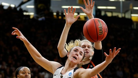 <p>               Iowa forward Hannah Stewart, front, fights for a rebound with Mercer center Rachel Selph during a first-round game in the NCAA women's college basketball tournament, Friday, March 22, 2019, in Iowa City, Iowa. Iowa won 66-61. (AP Photo/Charlie Neibergall)             </p>