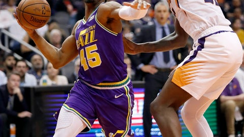 <p>               Utah Jazz guard Donovan Mitchell (45) drives as Phoenix Suns center Deandre Ayton defends during the first half of an NBA basketball game Wednesday, March 13, 2019, in Phoenix. (AP Photo/Matt York)             </p>