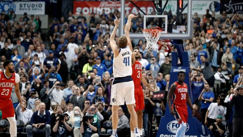 <p>               Dallas Mavericks forward Dirk Nowitzki (41) shoots as New Orleans Pelicans' Kenrich Williams (3) defends and Pelicans' Julius Randle (30) and Anthony Davis (23) watch in the first half of an NBA basketball game in Dallas, Monday, March 18, 2019. With the basket, Nowitzki became the NBA's sixth-leading scorer. (AP Photo/Tony Gutierrez)             </p>
