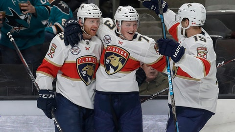 <p>               Florida Panthers left wing Dryden Hunt, center, is congratulated by defenseman Mike Matheson, left, and center Riley Sheahan after scoring a goal against the San Jose Sharks during the second period of an NHL hockey game in San Jose, Calif., Thursday, March 14, 2019. (AP Photo/Jeff Chiu)             </p>