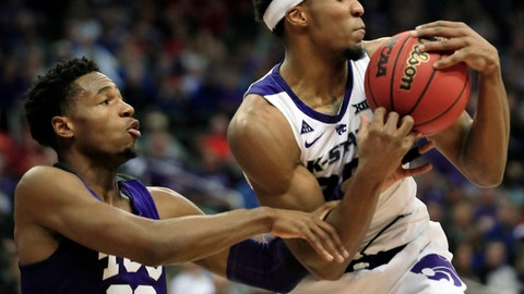 <p>               Kansas State forward Xavier Sneed, right, rebounds against TCU guard RJ Nembhard (22) during the first half of an NCAA college basketball game in the quarterfinals of the Big 12 conference tournament in Kansas City, Mo., Thursday, March 14, 2019. (AP Photo/Orlin Wagner)             </p>