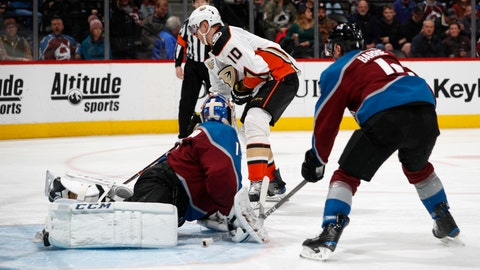 <p>               Anaheim Ducks right wing Corey Perry, back, shoots the puck for a goal past Colorado Avalanche goaltender Semyon Varlamov, front left, and defenseman Tyson Barrie during the second period of an NHL hockey game Friday, March 15, 2019, in Denver. (AP Photo/David Zalubowski)             </p>