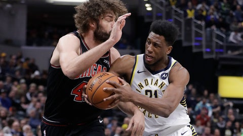 <p>               Indiana Pacers' Thaddeus Young (21) goes to the basket against Chicago Bulls' Robin Lopez (42) during the first half of an NBA basketball game Tuesday, March 5, 2019, in Indianapolis. (AP Photo/Darron Cummings)             </p>