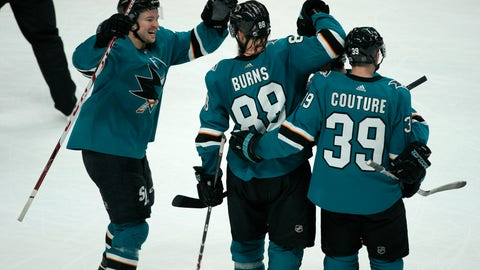 <p>               San Jose Sharks defenseman Brent Burns (88) celebrates with teammates Tomas Hertl, left, and Logan Couture (39) after scoring in overtime against the Vegas Golden Knights in an NHL hockey game Saturday, March 30, 2019, in San Jose, Calif. Sharks won 4-3. (AP Photo/Tony Avelar)             </p>