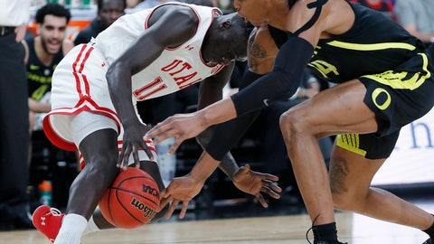 <p>               Utah's Both Gach, left, and Oregon's Kenny Wooten scramble for the ball during the first half of an NCAA college basketball game in the quarterfinals of the Pac-12 men's tournament Thursday, March 14, 2019, in Las Vegas. (AP Photo/John Locher)             </p>