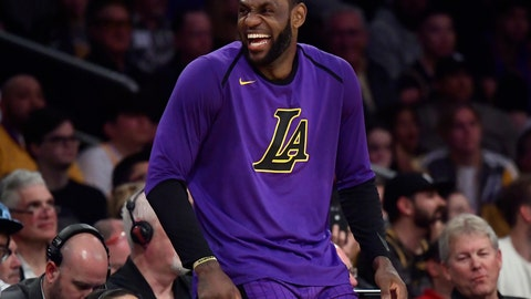<p>               Los Angeles Lakers forward LeBron James laughs as he waits to check in to the team's NBA basketball game against the Charlotte Hornets during the second half Friday, March 29, 2019, in Los Angeles. The Lakers won 129-115. (AP Photo/Mark J. Terrill)             </p>