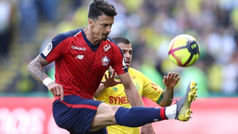 <p>               Lille's defender Mehmet Celik, left, gets to the ball ahead of Nantes' forward Valentin Eysseric during a French League One soccer match between Nantes and Lille at La Beaujoire Stadium in Nantes, western France, Sunday, March 31, 2019. (AP Photo/David Vincent)             </p>