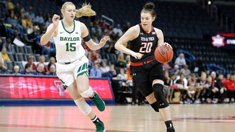 <p>               Texas Tech forward Brittany Brewer (20) drives to the basket as Baylor forward Lauren Cox (15) defends during the first half of an NCAA college basketball game in the Big 12 women's conference tournament in Oklahoma City, Saturday, March 9, 2019. (AP Photo/Alonzo Adams)             </p>